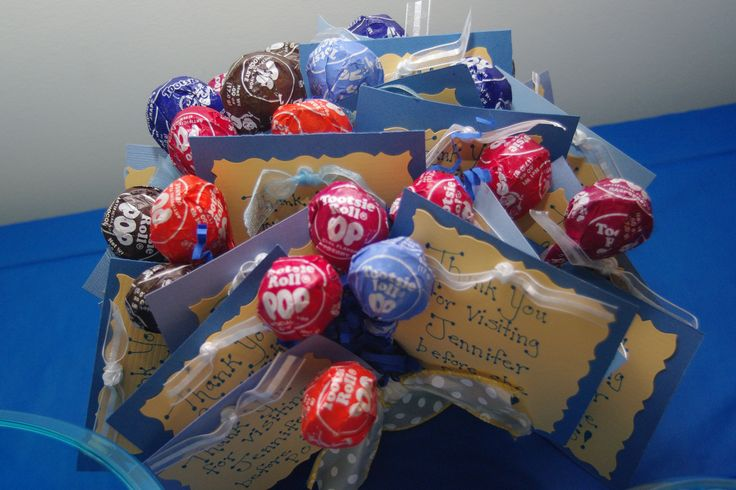 """A party favor for baby shower guests.  Card says """"Thank you for visiting _____  before she pops"""" and then use tootsie roll pops."""