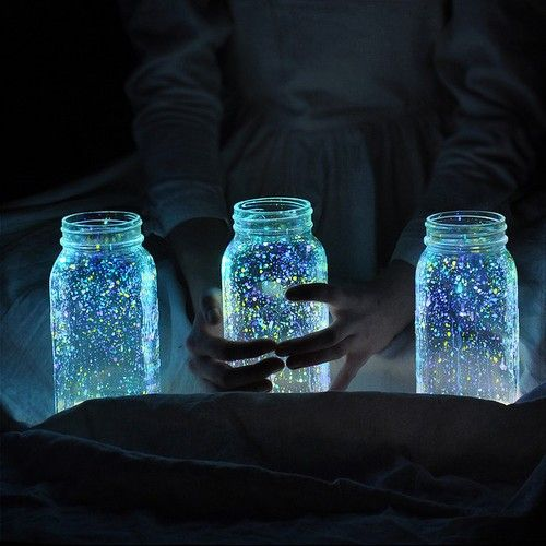I'm in love with this idea… and such a cool alternative to patio lights.  All you have to do is gather a few mason jars, flick some glow-in-the-dark paint in the jars, and let them sit in the sun to charge during the day. By the time your dinner party rolls around you'll have firefly lanterns. I think it would be cute to do this same thing with mini jars, and string them up somehow… hmmm