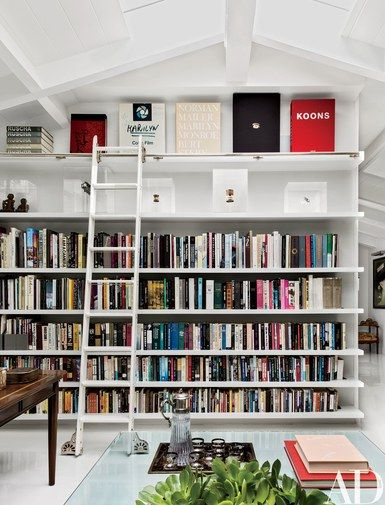 The office shelves are lined with art books and personal treasures, including a Campbell's soup can signed by Andy Warhol | archdigest.com