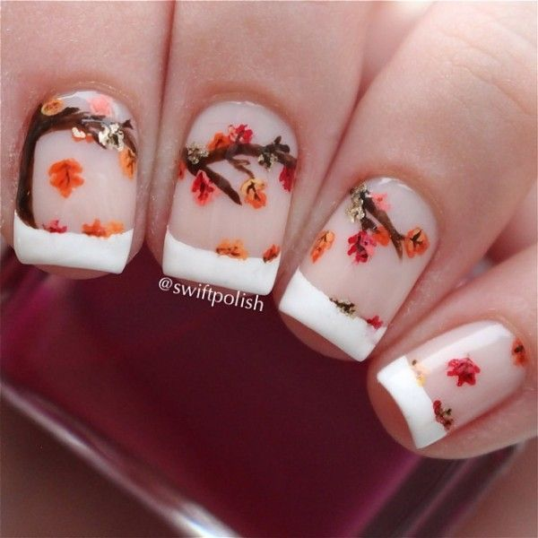 A wonderful French tip consisting of tree branches and falling leaves perfect for the fall season.