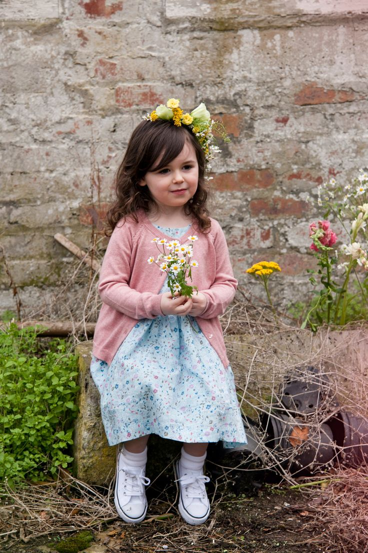 Printed dress worn with knitted pink cardigan, all Leigh Tucker Willow
