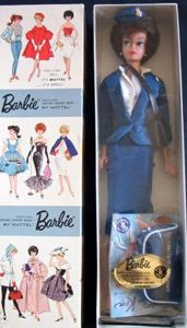 Vintage Barbie American Airlines Stewardess #984 (1961-1964)  Navy Jacket with Wings  Navy Sheath Skirt  White Body Blouse  Navy Hat with Wings  Black Shoulder Purse  Navy Flight Bag  Black Open Toe Heels