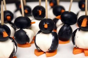 Olives, cream cheese, carrots... cheap and adorable Christmas party appetizer.