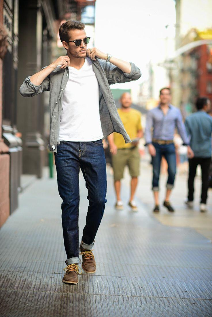 Comprar ropa de este look:  https://lookastic.es/moda-hombre/looks/camisa-de-manga-larga-camiseta-con-cuello-en-v-vaqueros-zapatos-derby-gafas-de-sol-reloj/5594  — Gafas de Sol Negras  — Reloj Plateado  — Camiseta con Cuello en V Blanca  — Camisa de Manga Larga Gris  — Vaqueros Azul Marino  — Zapatos Derby de Cuero Marrónes