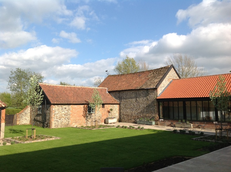 The courtyard in early spring!  Just after being landscaped this winter.  All the plants and trees are settling in beautifully ready for some gorgeous summer celebrations
