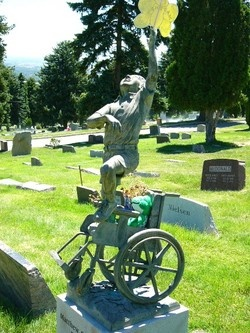 This unique monument shows the young boy jumping upward, out of his wheelchair. Confined to the chair most of his young life, he is now free of earthly burdens