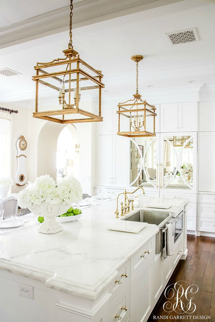 Soothing Summer Home Tour 2017 - Neutral Transitional Home Decor. White kitchen with marble and polished brass lantern lights.