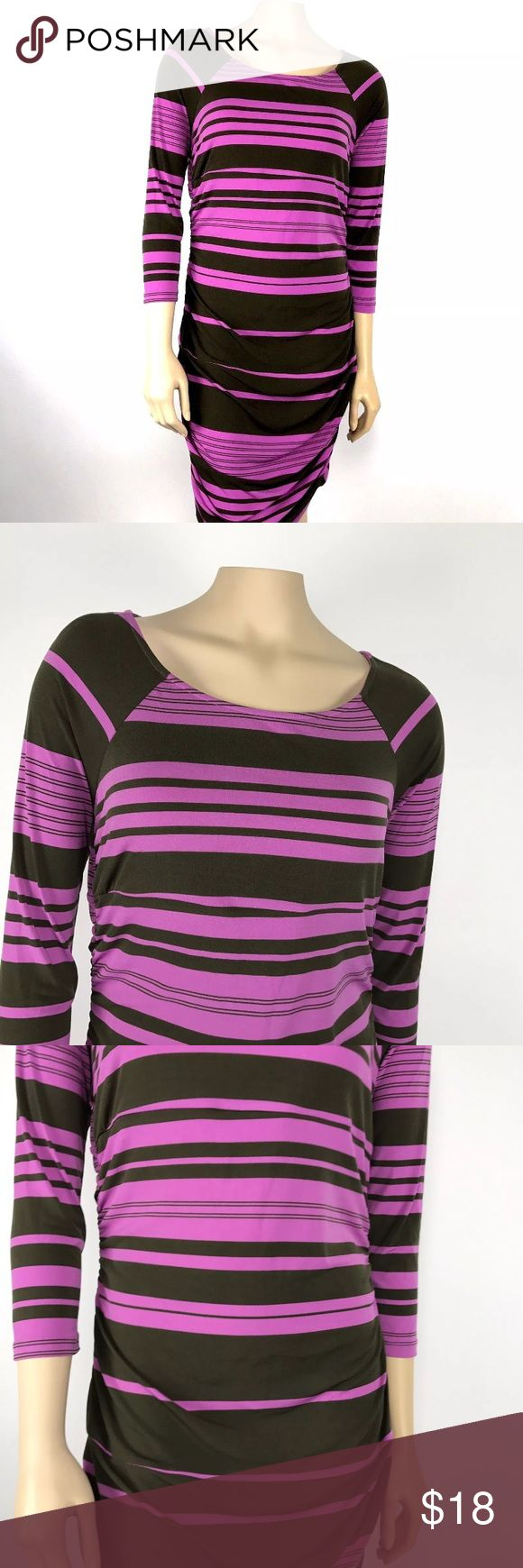 "Sofia Vergara Ruched Dress Women's size large purple & brown striped Sofia Vergara ¾ length sleeve, ruched stretch dress. 95% polyester, 5% spandex.        Measurements (flat lay): Armpit to armpit – 17 ½"" Length – 38""   Comes from a smoke free home!    Pre-owned. In good condition. No rips, tears, holes or stains. Sofia Vergara Dresses"
