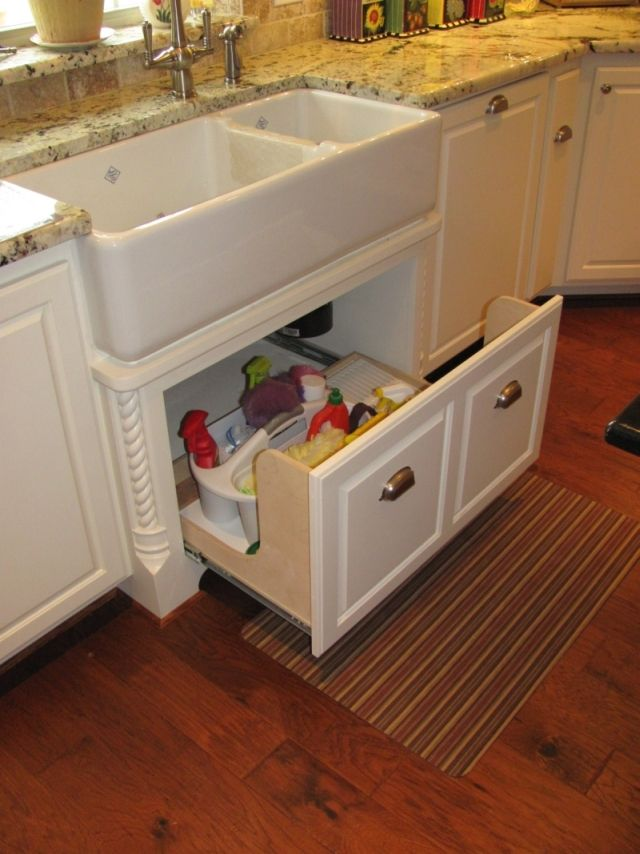 Apron sink drawer - Great idea, since it's always difficult to reach items under the sink in the back! (Although, this is probably a plumber's nightmare)