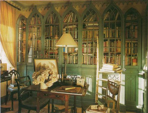 cathedral window bookcases-while i don't love this room, these bookcases could be nice in a simpler room, maybe in white. and built into the wall.