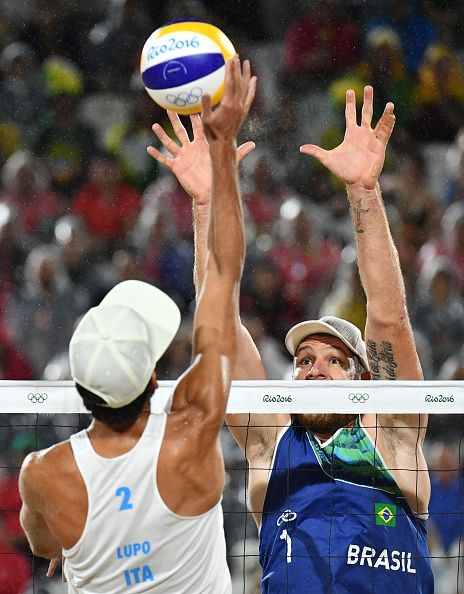 Italy's Daniele Lupo spikes the ball during the men's beach volleyball final…