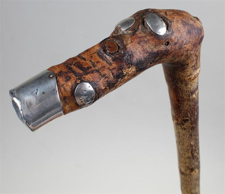 Lot 334 - William Percy Edgar Rose walking stick, the stick set with silver plaques to the knots, assayed for
