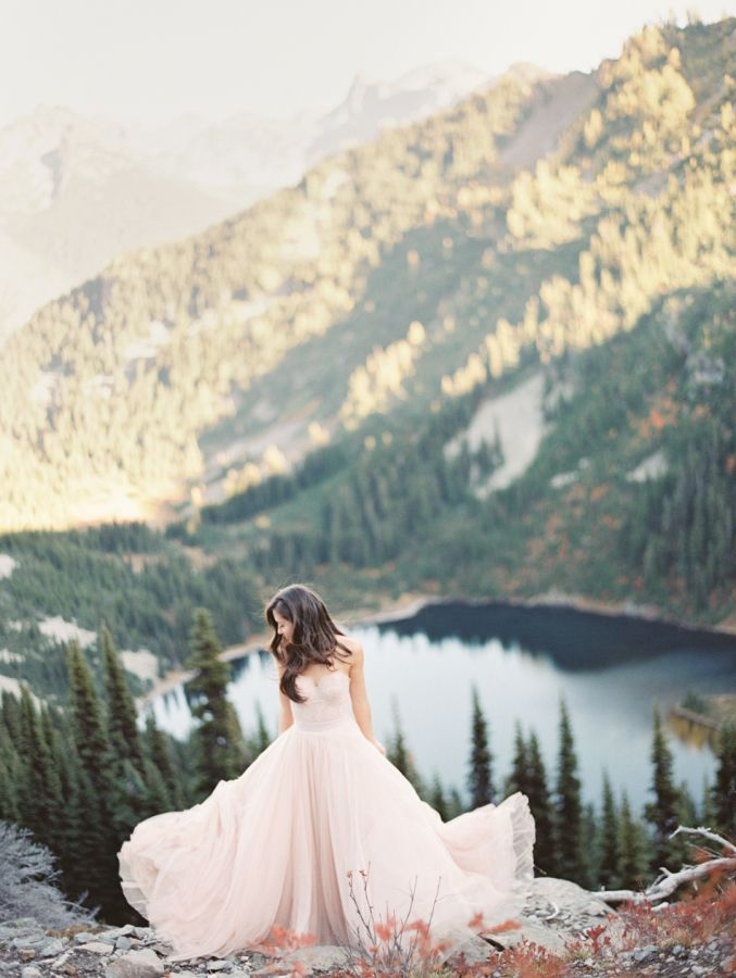 A blush gown and stunning Cascade Mountains backdrop: http://www.stylemepretty.com/2015/11/27/fall-seattle-wedding-romantic-newlywed-session-at-cascade-mountains/ | Photography: Christine A Clark - http://www.christineclarkphoto.com/