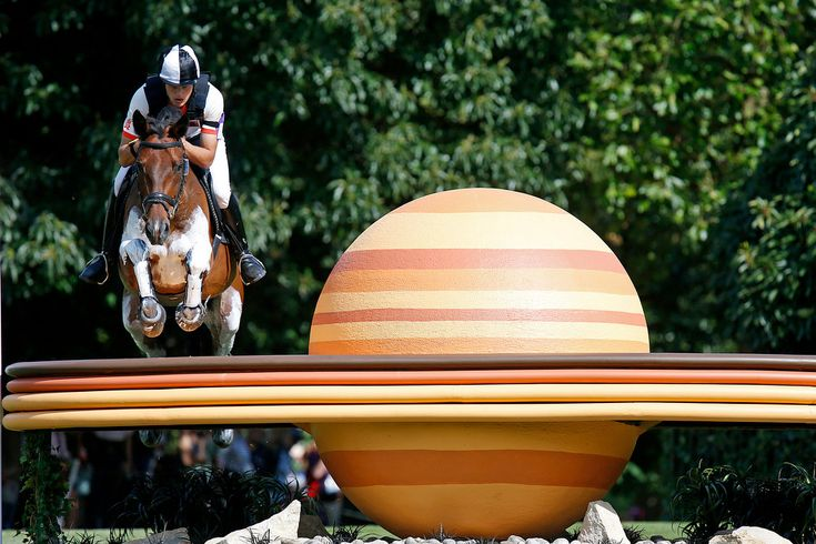 Belarus' Aliaksandr Faminou on Pasians competes in the equestrian eventing cross-country stage at the 2012 Summer Olympics, Monday, July 30, 2012, in London. (AP Photo/Jae C. Hong)