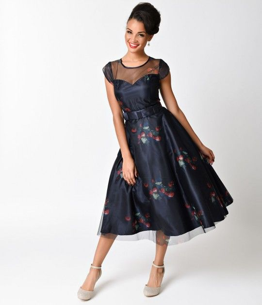 Elegance is about being remembered, darlings! A stunning mid-century navy blue marvel boasting a sweetheart bodice, princess seams, and a stunning swing skirt. Overlay poly organza with subtle floral accents give a graceful illusion scoop neckline and cha