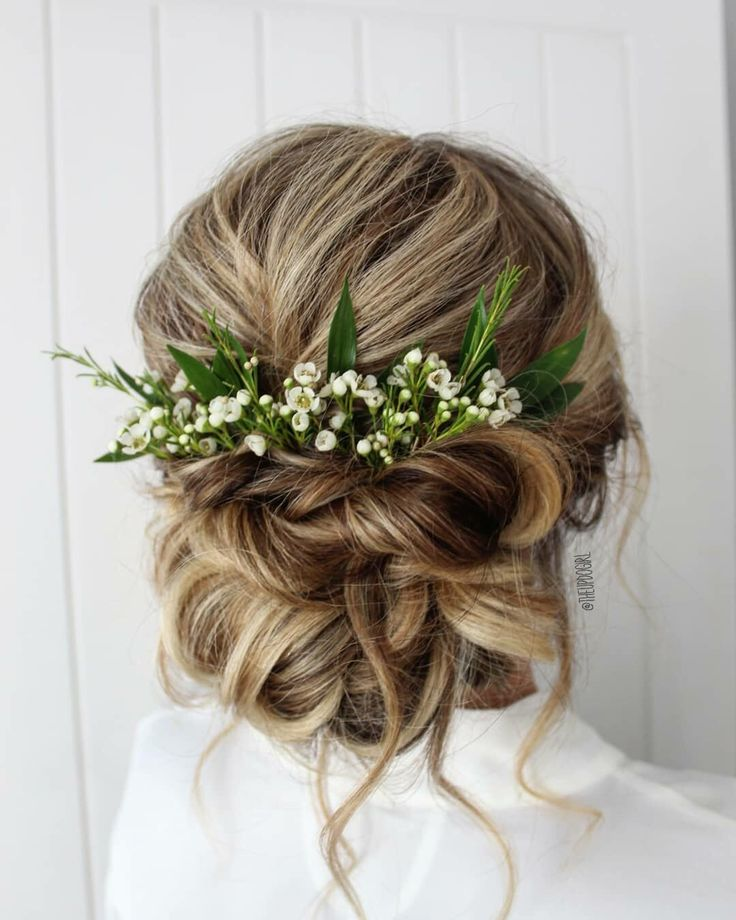 Soft tousled romantic blonde bridal updo