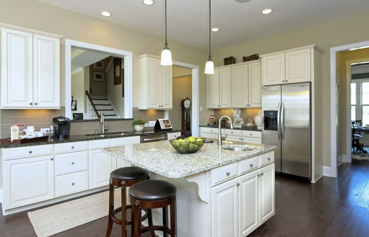 Traditional Kitchen with Kitchen island, Progress Lighting Wisten Mini Pendant, Simple granite counters, Raised panel, Flush