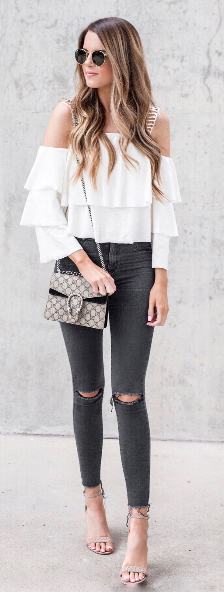 #spring #fashion White Open Shoulder Ruffle Top & Black Ripped Skinny Jeans & Grey Sandals