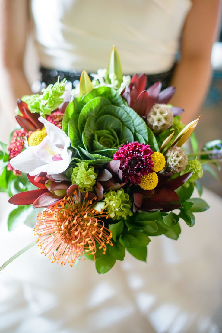We love a bouquet with a little spunk | Chicago Wedding at Loft on Lake from Gina Cristine Read more - http://www.stylemepretty.com/illinois-weddings/2013/10/03/chicago-wedding-at-loft-on-lake-from-gina-cristine/