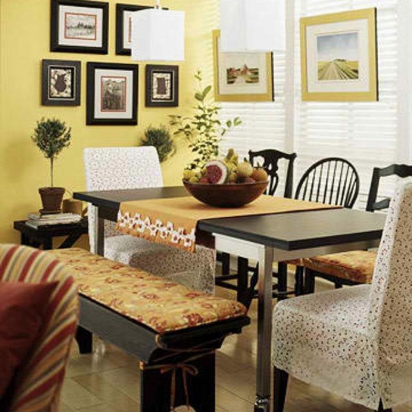 Love the mismatched chairs and that bench! <3