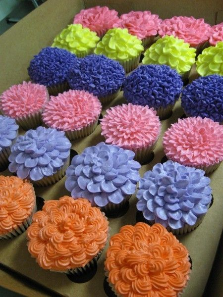 Flower cupcakes - different colors for Karlee, but good petal icing ideas.