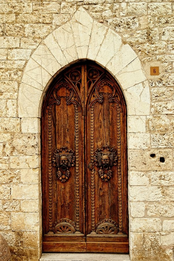 Beautiful door in Assisi by Fabio Cappellini,
