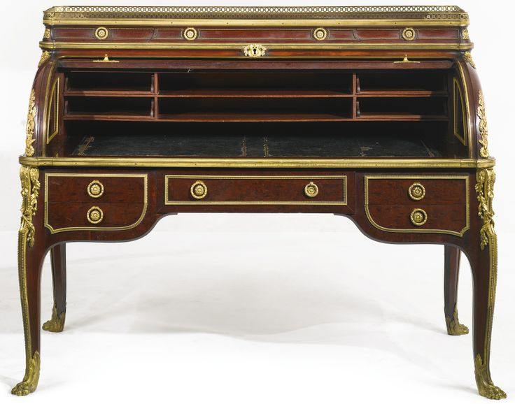 FRANÇOIS LINKE 1855 - 1946 A LOUIS XVI STYLE GILT-BRONZE MOUNTED PLUM PUDDING MAHOGANY BUREAU À CYLINDRE PARIS, LATE 19TH CENTURY, INDEX NUMBER 40, AFTER THE MODEL BY JEAN-HENRI RIESENER the upper structure fitted with three small drawers, the cylinder opening to six filing compartments and a blue leather lined writing slide, above five frieze drawers, the escutcheon has been removed to reveal the FL mark from the bronze master model height 46 in.; width 60 1/2 in.; depth 32 in.