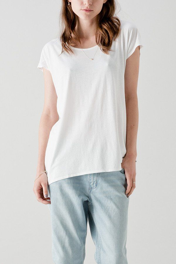 From White Labels Winter '16 Collection, an ongoing line of high quality basics. - Cropped sleeve- Scoop neck tshirt with shirt tail hemline.  - Regular fit Fabric: 70% Bamboo 30% Cotton Jersey Size & Fit: Model is 168cm tall and wears a size 10 AU