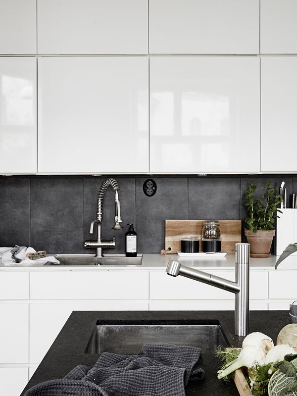 Now that's a beautiful kitchen. White, a dark slate, and stainless. Maybe make the countertops of concrete to finish off the industrial look.