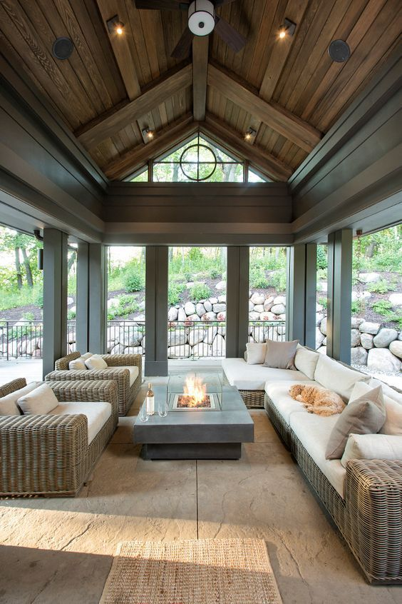 The screened-in porch features stained shiplap ceiling and dark trim painted in Sealskin Sherwin Williams SW7675.