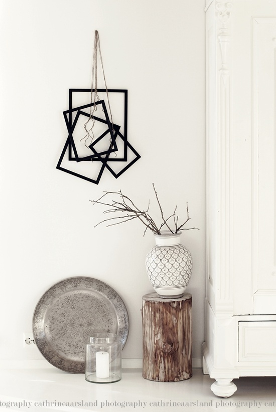 I like the picture frames on the wall. Can do without the stuff on the floor.