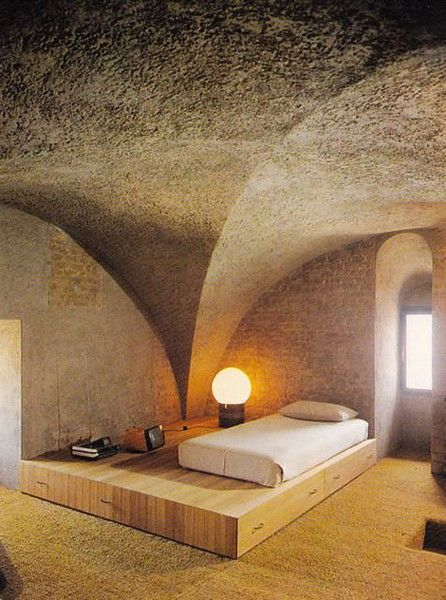 Bedroom with furniture designed by Gae Aulenti