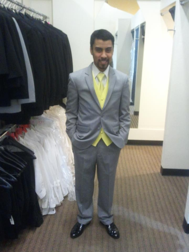 This Client looking sharp in a Grey Suit with Yellow Vest and Tie.