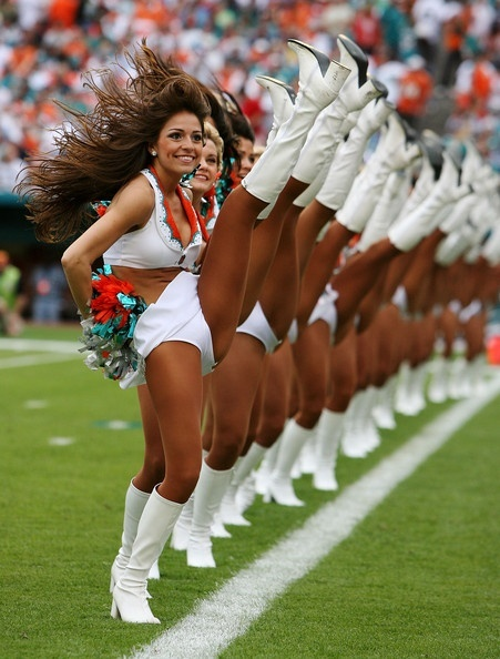 Cheerleaders Kicking high