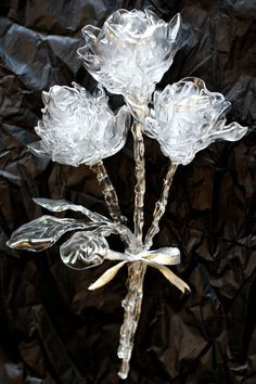 Roses made from melted plastic spoons.