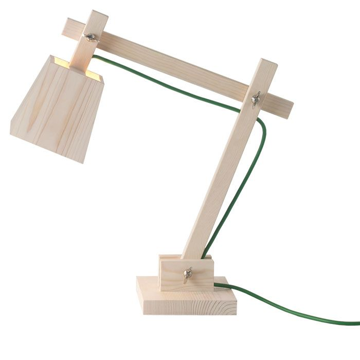 Muuto's Wood Architect Lamp. The all-wood lamp is a lo-tech counterweight to the usually very modern and technical desk lamps. Rendered in pine and available with a cord in Green or White.