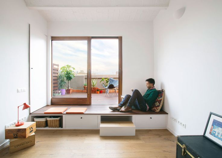 Barcelona apartment renovation by Nook with tiles and window seat