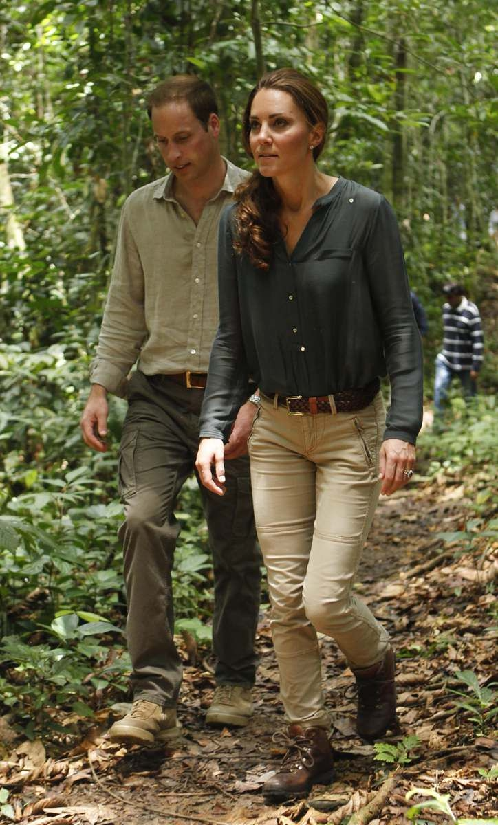 September 15, 2012: Prince William and Kate Middleton explore the rainforest in Malaysia's Danum Valley Conservation Area. Kate is wearing khaki cargo pants and a dark-green Zara blouse.