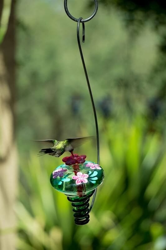 Bring magic to the garden with Parasol's newest Botanica series... hummingbirds adore Blossom Feeders! Hand-painted blown glass feeder may be staked or hung to attract and keep tiny sprites coming bac