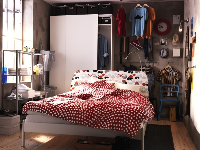 bedroom furniture with a bed with colourful bed clothes and shelf units - Complete Bedroom Decor