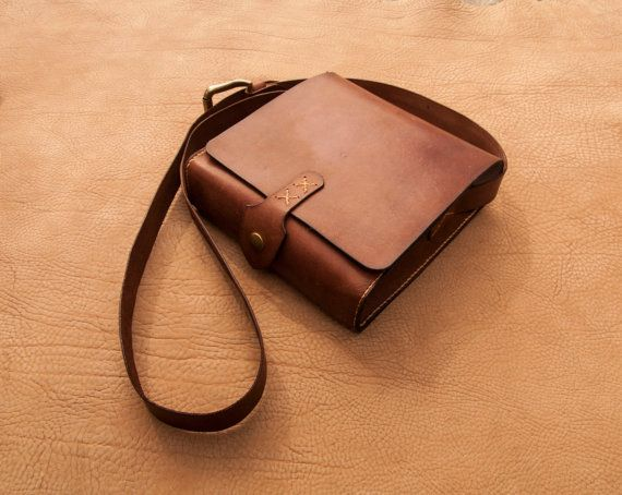 Handcrafted cross body / messenger bag crafted from full grain vegetable tanned leather. Hand cut ,hand dyed and hand stitched using a saddle