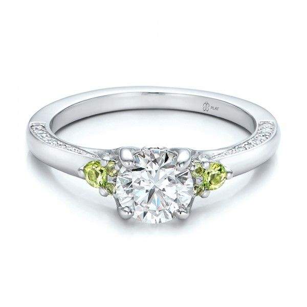 Custom Peridot and Diamond Engagement Ring with yellow diamonds on the side rather than peridot