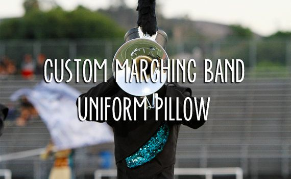 makes a pillow from a sketch of band uniform! :DD