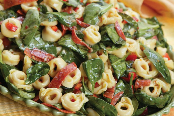 Refreshing and easy to make, this lemony tortellini salad takes full advantage of spring's tender baby spinach.