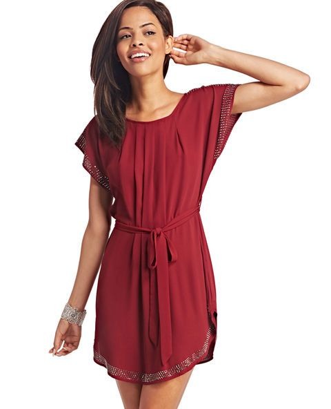 "<p>Shift into fancy when you wear this flowy little dress. It features a solid breezy chiffon body, gorgeous beaded details at the sleeves and hem, flattering front pleats, and a double scoop neckline. The dress includes a sash for figure-defining wear, or wear it loose and pair with a faux leather jacket.</p>  <p>Model is 5'9"" and wears a size small.</p>  <ul> 	<li>34"" from shoulder to hem</li> 	<li>100% Polyester</li> 	<li>Hand Wash</li> 	<li>Imported</li> </ul>"