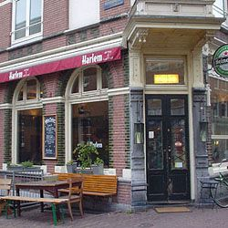 Cafe Harlem  Amsterdam, Netherlands. Really good chicken, brie, and sundried tomato sandwich.