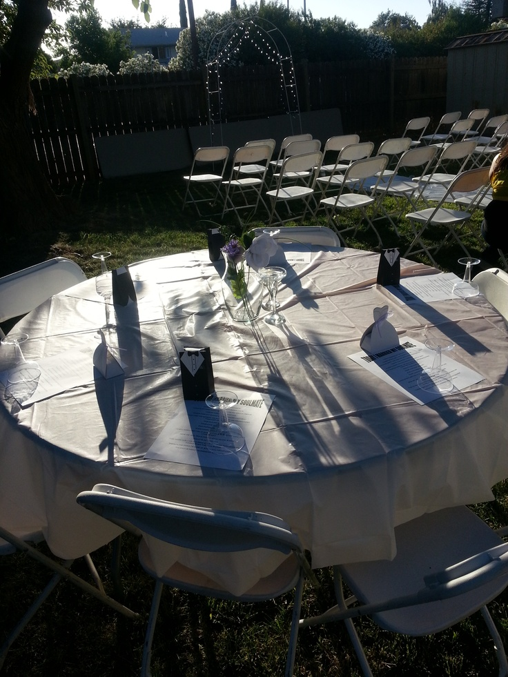 one guest table and also the aisle seating. The walkway is lined with hanging candle lanterns that I made out of mason jars. They were removed after the ceremony & used to mark the area for the first dance!