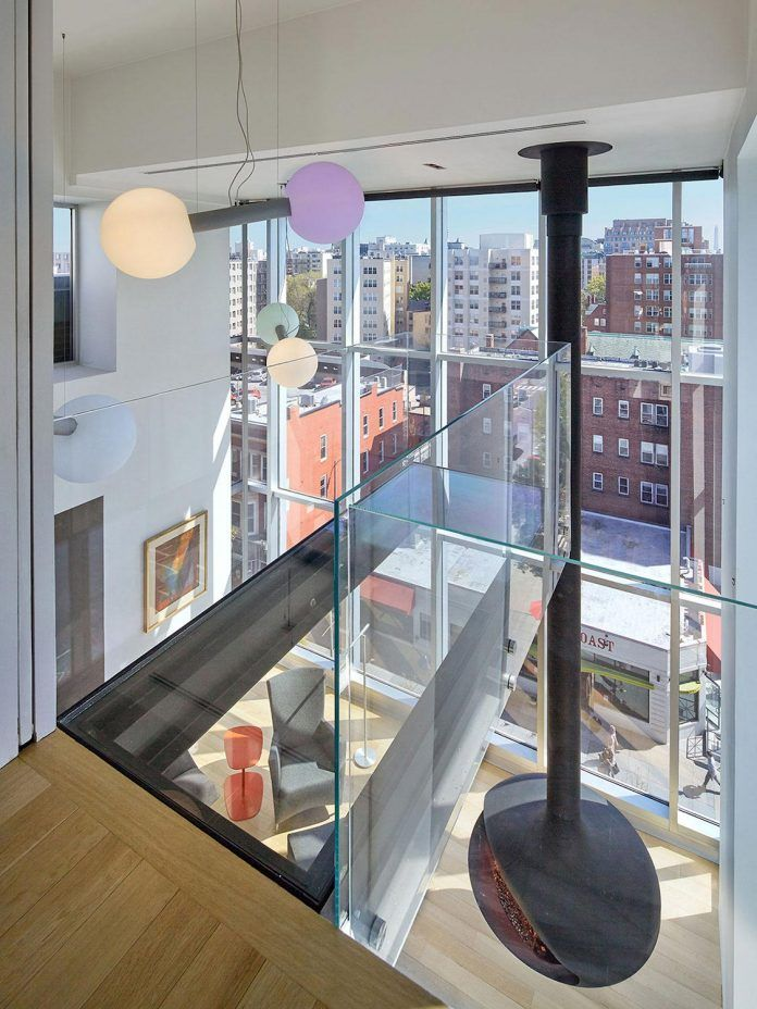 Penthouse with large double height space, anchored at the corner with expansive two-story walls of glass - CAANdesign