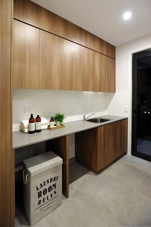 Caesarstone's concrete-look benchtop perfectly complement the warm wood tones in the polytec Sepia Oak cabinetry.