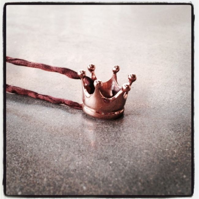 Necklace with crown as our company logo Crystal Queen from pink gold-plated silver in a brown silk lace Price: 39€
